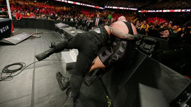 Roman Reigns spears Big Show through the barricade image: wwe.com