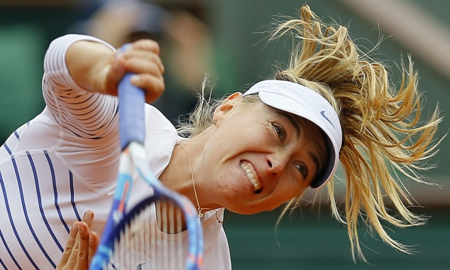 Maria Sharapova kept hopes of retaining her French Open title alive image: theguardian.com