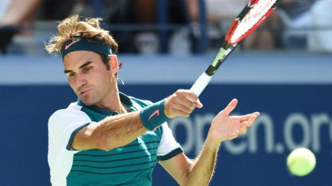 Roger Federer remains on course for his first grand slam since 2012 image: sports.yahho.com