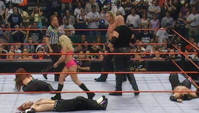 Trish Stratus and T&A beat down Lita and The Hardys after thier match image: wwenetwork