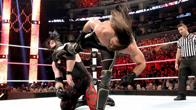 Seth Rollins right-foot connects with Kane's chin image: wwe.com