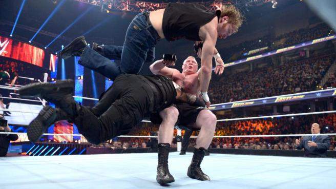 Dean Ambrose goes flying as Reigns hits a spear on the Beast image: wwe.com