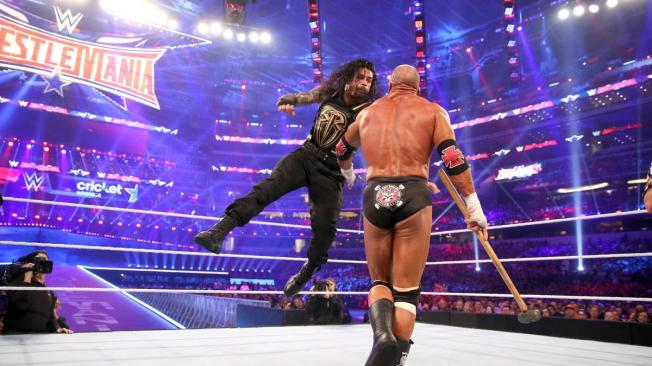 Roman Reigns nails Triple H with a superman punch image: wwe.com