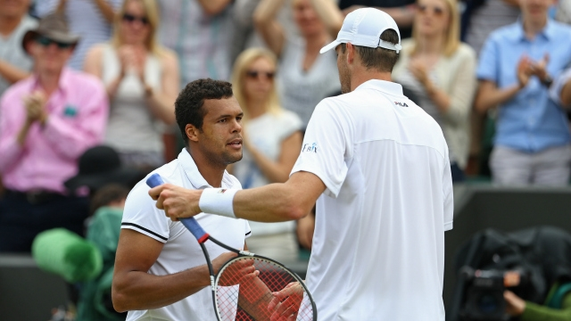 Jo Wilfired Tsonga edged past John Isner 19-17 in the final set image: ourncr.com