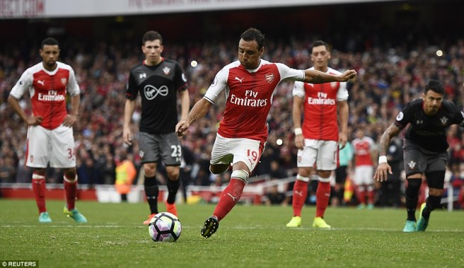 Santi Carzola's late penlaty handed Arsenal all three points against Southampton image: dailymail.co.uk