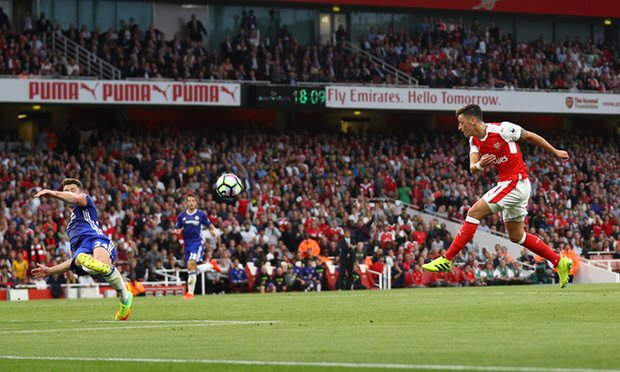 Mesut Ozil added a third before half time as Arsenal thrashed Chelsea image: theguardian.com