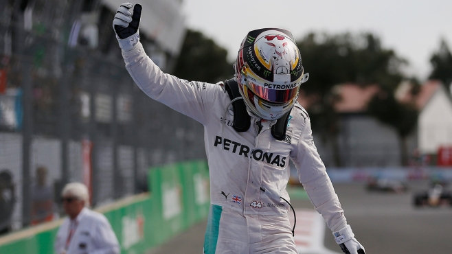 Lewis Hamlton made it back to back victories to keep tabs on Nico Rosberg image: news--of-the-day.com