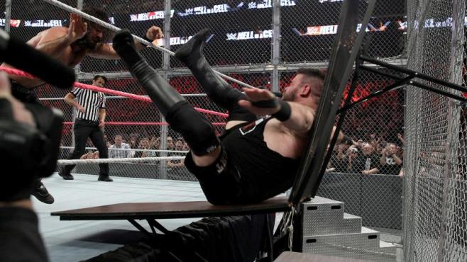 Kevin Owens overcame a powerbomb thorugh two tables to retain the Universal Title image: wwe.com