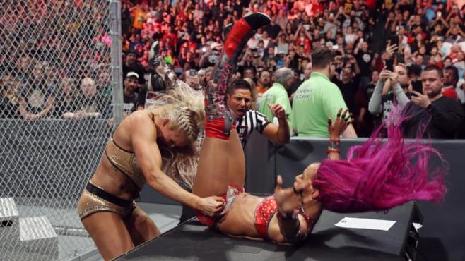 Charlotte powerbombed Banks throught he announcers atble before the match even began image: wwe.com