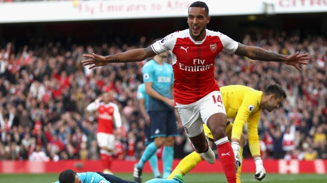 Theo Walcott took his goal tally to five with a barce in Arsenal's win over Swansea image: skysports.com