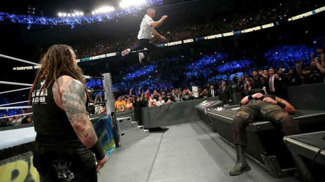 Shane McMahon sends Braun Strowman crashing through the announcers desk image: wwe.com