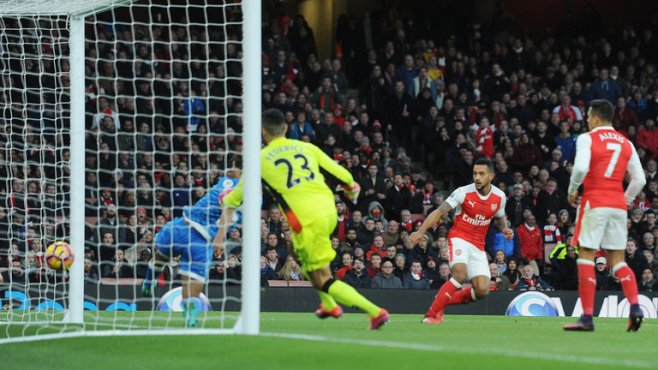 Theo Walcott heads in Arsenal's second goal in their first win in three league games image: skysports.com