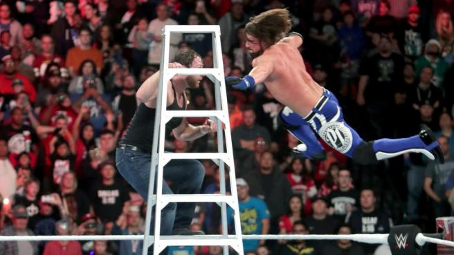 AJ Styles takes Dean Ambrose off the ladder with a Phenomonal forearm image: wwe.com