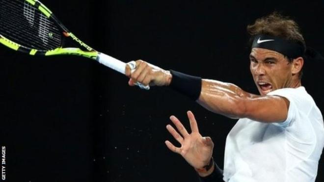 Rafael Nadal was made to work by Gaels Monfils to set up a quarter-final with Milos Raonic image: bbc.com